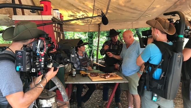 Andrew Zimmern films a segment with chuckwagon cook Kent Rollins, who has appeared on many national chef TV shows, earlier this week at Branson's Silver Dollar City.