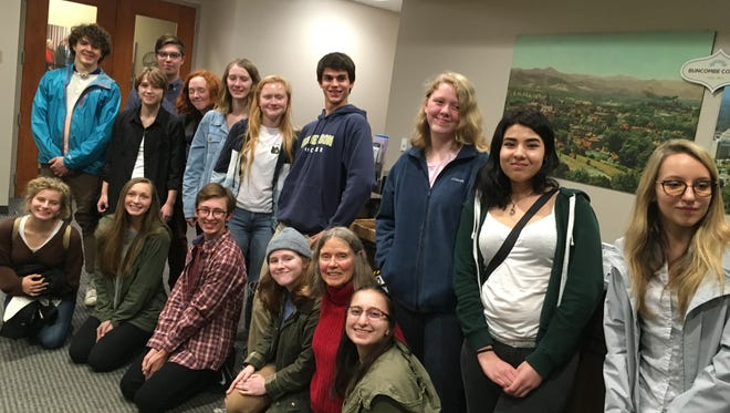 Students in the Youth for Environmental Stewardship group, including Harmony Kunst, standing third from right, and Tallulah Cloos, sitting third from right and Judy Mattox, sitting second from right, the executive committee chair of WENOCA Sierra Club, presented a petition to the Buncombe County commissioners Dec. 5.
