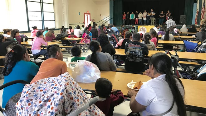 Immigrant families in Ventura County listen during a community meeting in November held to reassure them they are safe to seek healthcare, regardless of immigration status.