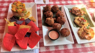 The three most popular starters at Conchy Joe's, from left to right: shrimp stack, conch fritters and conch cakes.