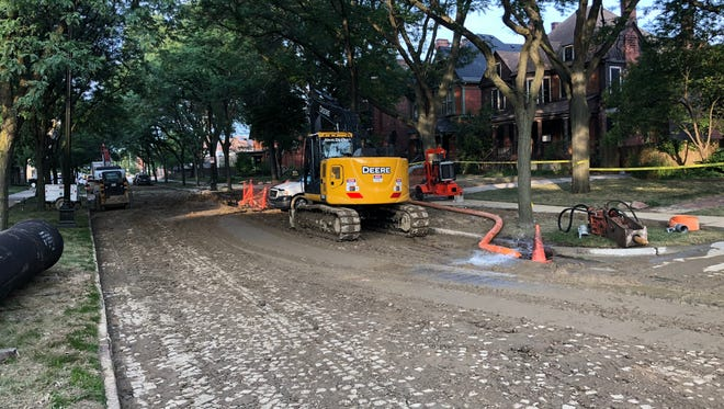 The scene of a water main break on Canfield Street in Detroit on July 29, 2018. The water main broke on the previous day.