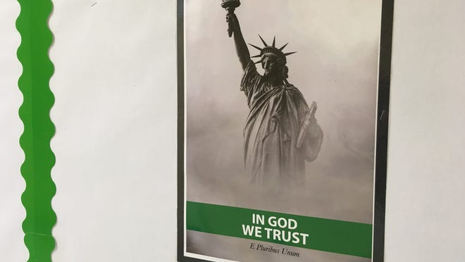 "The ""In God We Trust"" poster being used by the Clarksville-Montgomery County School System was designed by intern Adia Muhammad."
