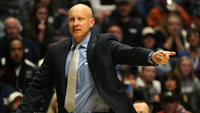Xavier Musketeers head coach Chris Mack instructs the team in the first half of the second-round West Region NCAA Tournament game between the Xavier Musketeers and Florida State Seminoles, Sunday, March 18, 2018, at Bridgestone Arena in Nashville.