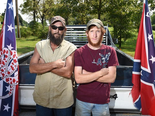 Self-avowed father and son rednecks, Henry Rowden, left, and Levi Rowden, say redneck means freedom. According to a recent online ranking of the most redneck cities in Arkansas, Mountain Home came in second.