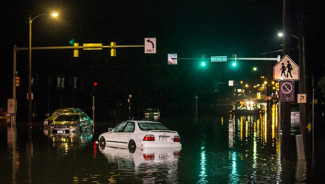 Water inundates the intersection of Sixth Avenue and Holcomb Avenue outside of North High School after a flash flooding event on Saturday, June 30, 2018, in Des Moines. At least six cars were stuck in the intersection.