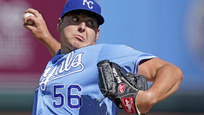 Kansas City Royals starting pitcher Brad Keller throws during the first inning of game one  against the Cincinnati Reds Wednesday in Kansas City, Mo.