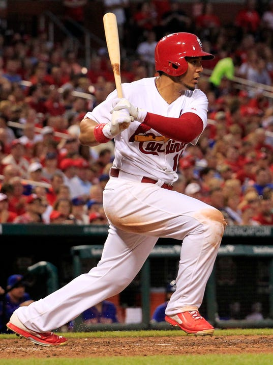 St. Louis Cardinals' Jon Jay watches his RBI triple during the fifth inning of a baseball game against the New York Mets Tuesday, June 17, 2014, in St. Louis. (AP Photo/Jeff Roberson)