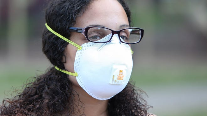 Rena Sargent wears her mask at Price Park in North Canton on Tuesday.