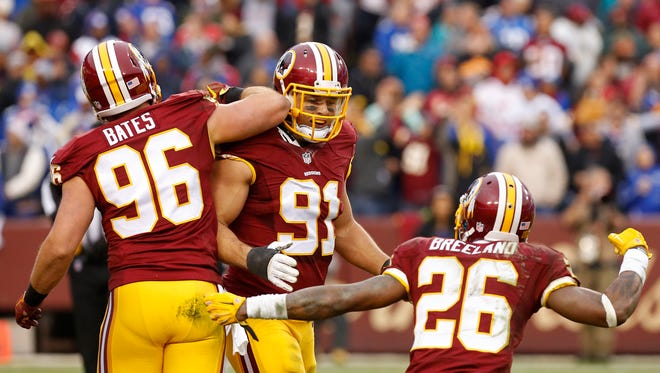 Redskins outside linebacker Ryan Kerrigan (91) celebrates with Redskins linebacker Houston Bates (96) and Redskins cornerback Bashaud Breeland (26) after a sack against the New York Giants in a game earlier this year.