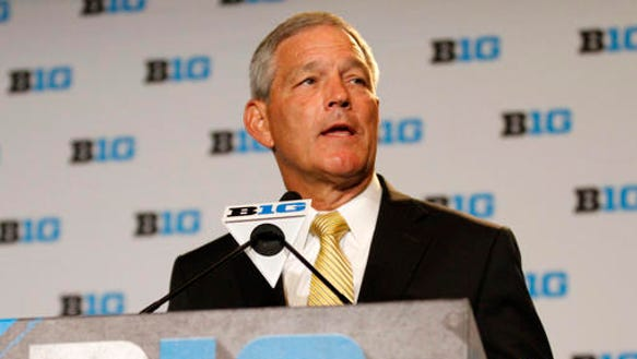 Iowa head coach Kirk Ferentz speaks to the media at