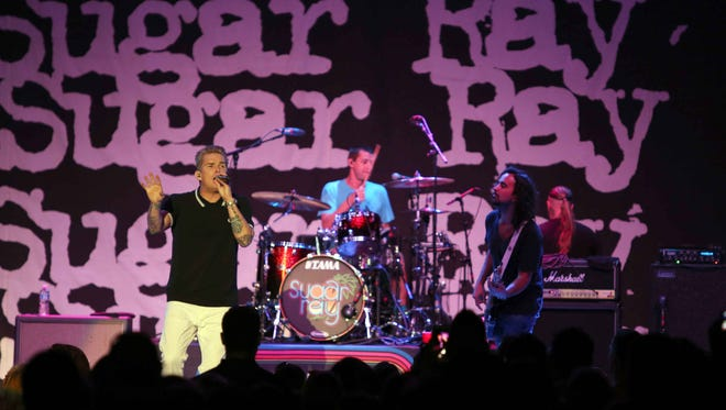 Rodney Sheppard, Mark McGrath, Jesse Bivona and Justin Bivona with Sugar Ray perform during the Under the Sun Tour 2015 at Chastain Park Amphitheater on Aug. 26, 2015, in Atlanta.