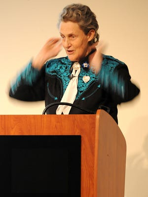 Temple Grandin motions while talking about autistic sensory issues during her speech Thursday evening at the Mid-Ohio Conference Center.