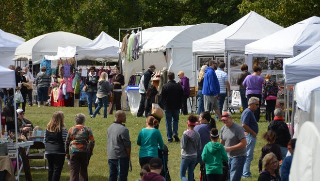 Visitors shop local artisan booths at Fall Fest at The Hermitage.