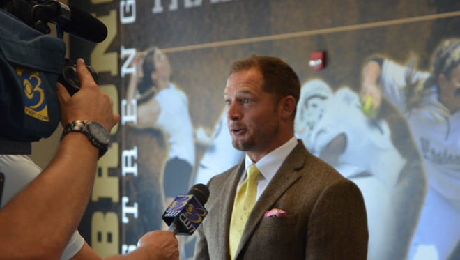 WMU head football coach P.J. Fleck does an interview with television station WWMT on Sunday during the team's annual media day.