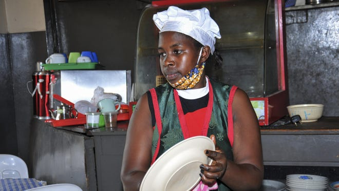 Rebecca Nakamanya works at a restaurant near a bus terminal in Kampala, Uganda. With business slow due to the COVID-19 pandemic, Nakamanya worries how to feed her three children.