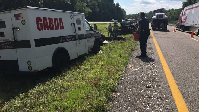 A wreck involving an armored car left coins strewn on I-40 Monday afternoon.