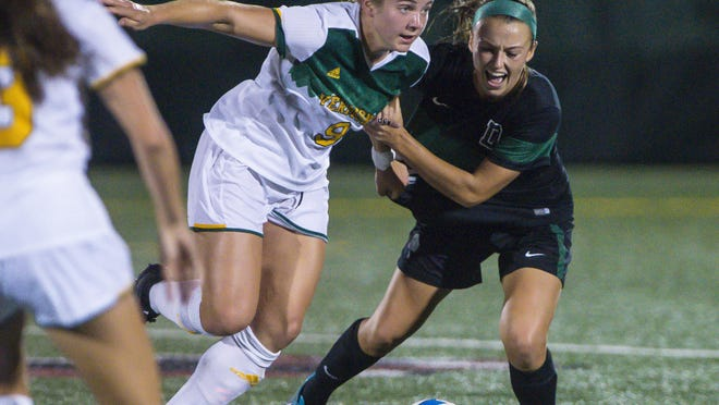 UVM's Alex Jenkins, left, tangles with Dartmouth's Lindsay Knutson on Tuesday.