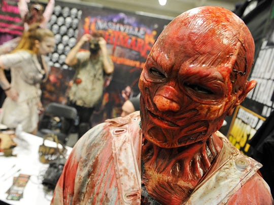 A member of Nashville Nightmare greets visitors  at the annual Full Moon Tattoo and Horror Festival.