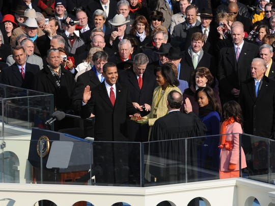 Obama takes the oath of office from Chief Justice John