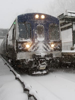 A Metro-North commuter train pulls into the Brewster station during steady snow on Feb. 9, 2017.