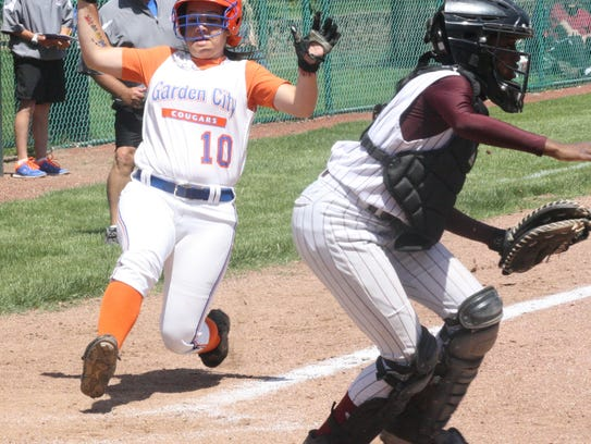 Hannah Vera-Burgos slides into home during GC's victory