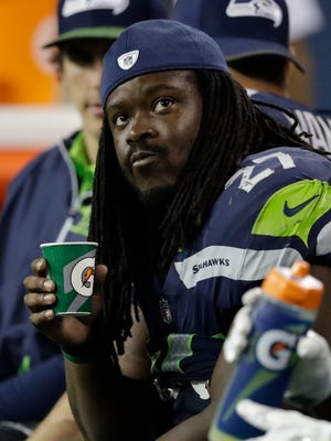 Seattle Seahawks running back Eddie Lacy sits on the bench in the second half against the Minnesota Vikings, Friday, Aug. 18, 2017, in Seattle.