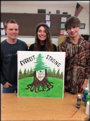 D.C. Everest Senior High School students Jesse Przybyliski, left, Johanna Gregory and Kyle Peterson created a school spirited tile that will be hung in the Army offices.