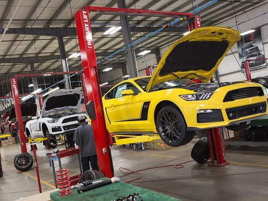 Customized Roush Mustangs are shown in development at Roush's Plymouth Township plant.