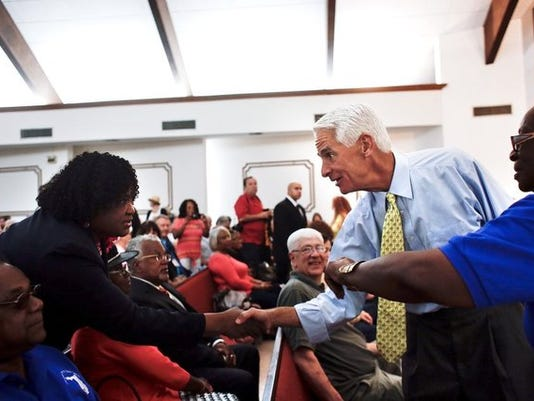 Democrat Charlie Crist, the state's former Republican governor, greets supporters at New Image Tabernacle Church during a meet-and-greet event in North Fort Myers on Monday, October 6, 2014.