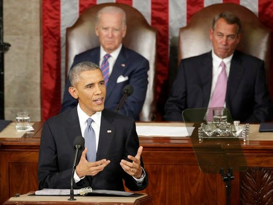 President Barack Obama gives his State of the Union address before a joint session of Congress on Capitol Hill in Washington, Tuesday, Jan. 20, 2015.Vice Presient Joe Biden and House Speaker John Boehner of Ohio listen. (AP Photo/J. Scott Applewhite)