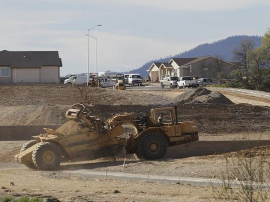 Construction takes place in 2016 at Palomar Builder's Highland Park development.