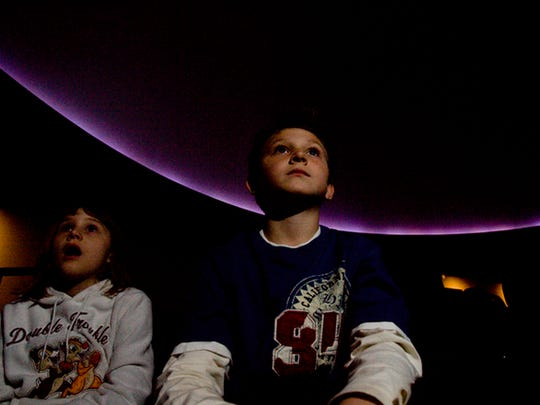 Sycamore Elementary School students Destiny Wade and Andrew Gilmette watch the show at the Schreder Planetarium in 2008.  The future of the planetarium is in doubt.