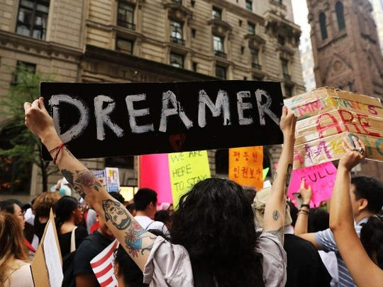 Dozens of immigration advocates and supporters attend a rally outside of  Trump Tower along Fifth Avenue on August 15, 2017 in New York City. The activists were rallying on the five-year anniversary of President Obama's executive order, DACA - Deferred Action for Childhood Arrivals, protecting undocumented immigrants brought to the U.S. as children.