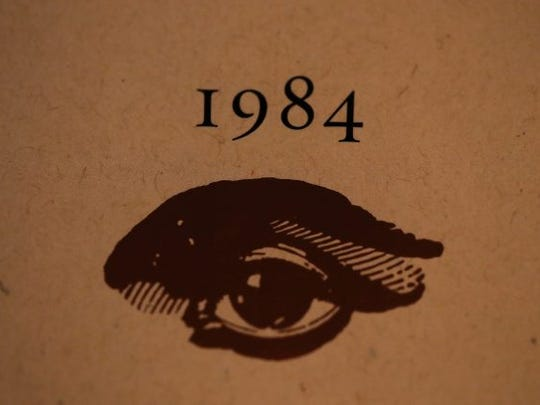 A copy of George Orwell's novel '1984' sits on a shelf at The Last Bookstore on January 25, 2017 in Los Angeles, California. George Orwell's 68-year-old dystopian novel '1984' has surged to the top of Amazon.com's best seller list and its publisher Penguin has put in an order for 75,000 reprints.