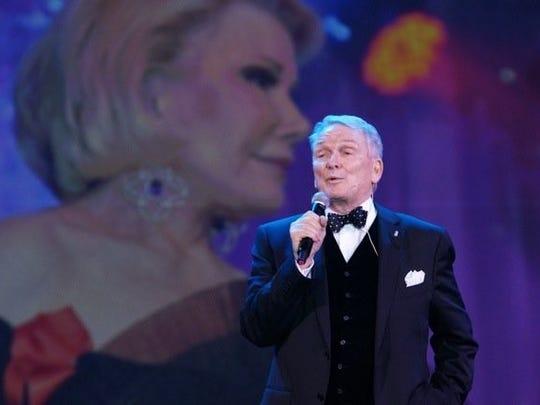 Designer Bob Mackie remembers Joan Rivers (on screen) in a tribute sponsored by Annette Bloch.