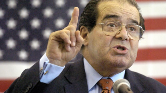 U.S. Supreme Court Justice Antonin Scalia speaks to Mississippi high school students in 2004. He died over the weekend.