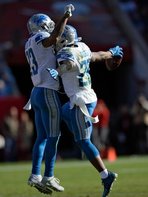 Detroit Lions cornerback Quandre Diggs, right, celebrates with cornerback Darius Slay after Diggs in the second half against Tampa Bay Buccaneers on Sunday, Dec. 10, 2017 in Tampa, Fla.