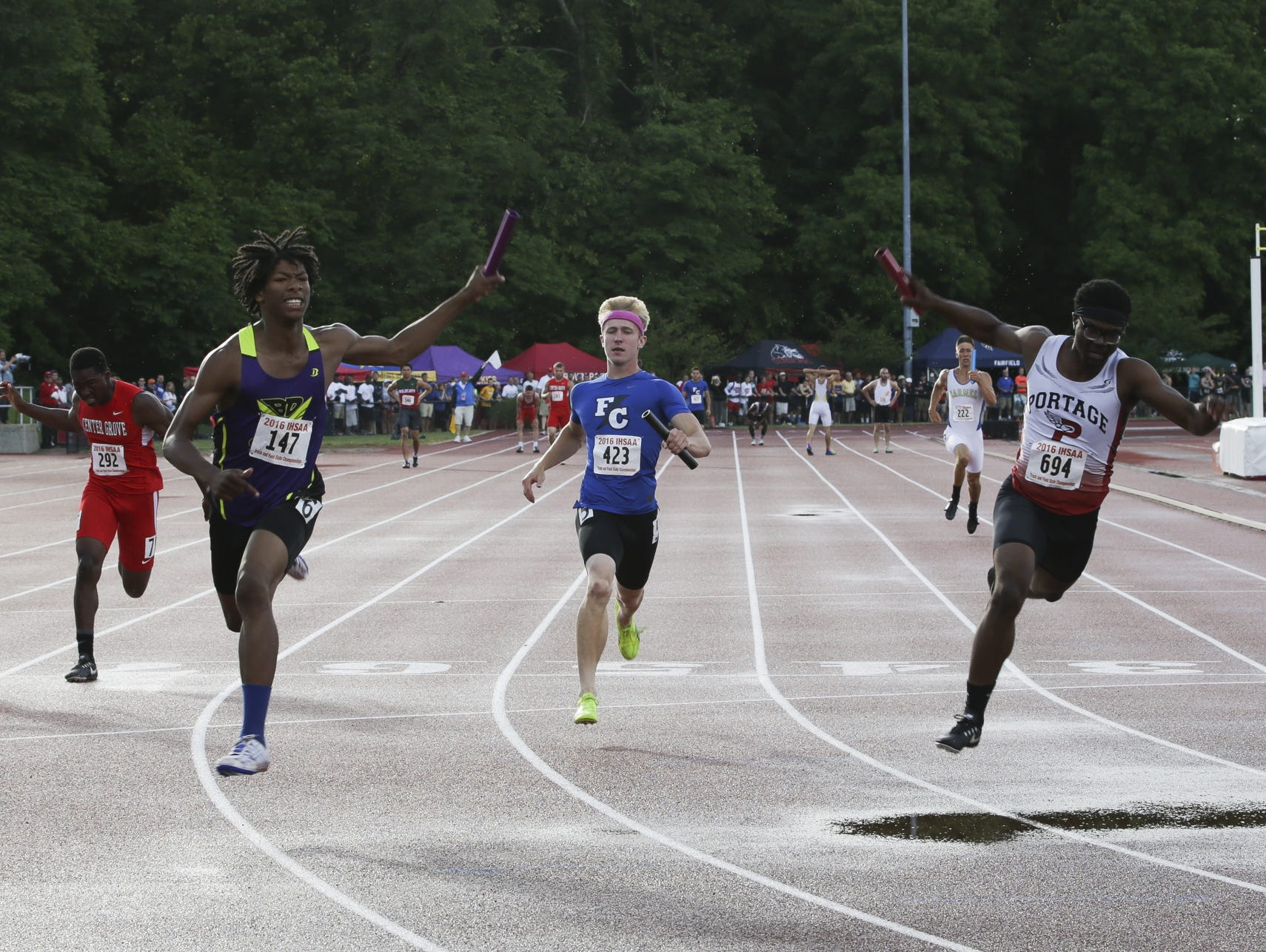 Christian Powell (left) and Ben Davis win the 400-meter relay at the IHSAA boys track and field state finals Saturday, June 4, 2016, in Bloomington.