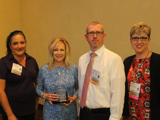 From left, Melissa Grandon, Patti Quintana, Julie Decker, Travis Stuart and Jennifer Fahrenkrug receive Acuity's Company of the Year Award from the Independent Insurance Agents of New Mexico.
