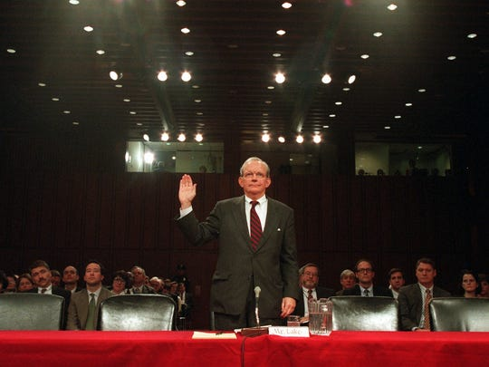 In this March 1997 file photo, Anthony Lake is sworn
