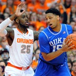 Syracuse forward Rakeem Christmas guards Duke center Jahlil Okafor during the Blue Devils' 80-72 victory at the Carrier Dome on Saturday night.