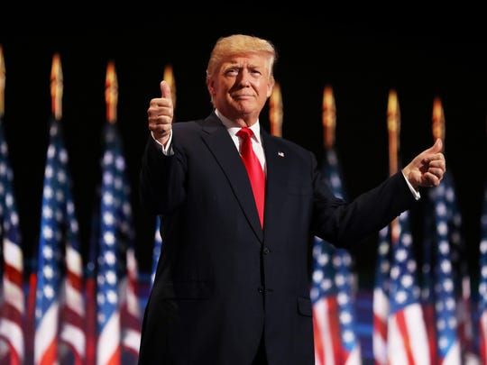 Republican presidential candidate Donald Trump gives two thumbs up to the crowd during the evening session on the fourth day of the Republican National Convention on July 21, 2016, at the Quicken Loans Arena in Cleveland, Ohio.