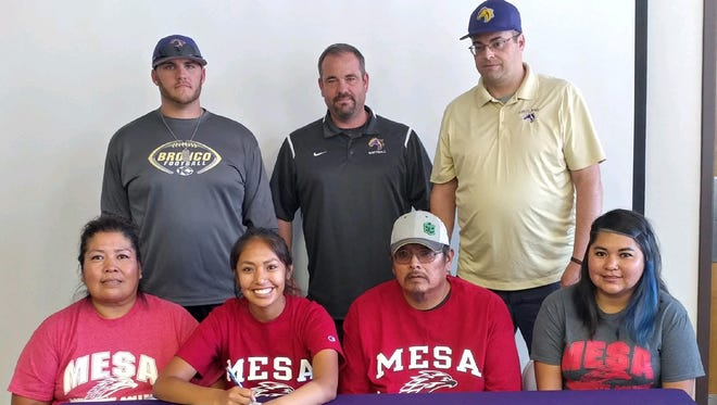 Nikki Begay, second from left, signs a letter of intent to play softball for Mesa Community College.