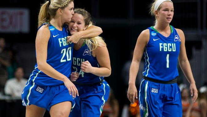 FGCU's Haley Laughter (20) gives Taylor Gradinjan (24) a kiss after Gradinjan scored a three-pointer to tie the game in the final seconds of action against Miami during the second half of action at the Watsco Center Saturday, March 18, 2017 in Coral Gables, Fla. Despite her efforts FGCU would lose to Miami 62-60 in a game that went to the final seconds.