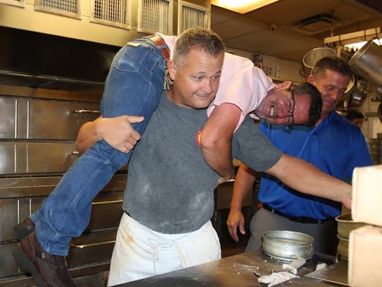 Scott Van Duzer gives volunteer Giovanni Barbieri a