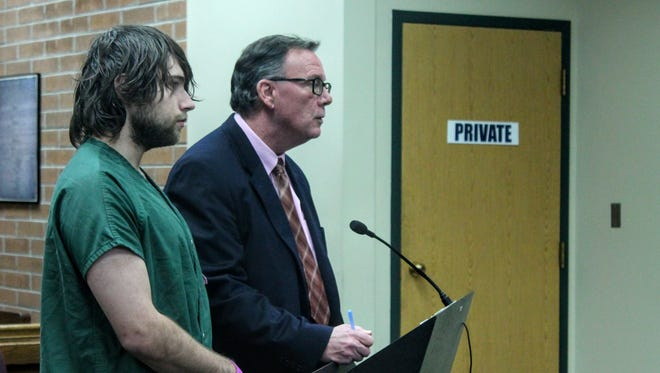Justin Paul, 22 of Westland, stands with his attorney, David Lankford, in Westland's 18th District Court.
