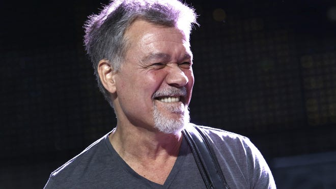 Eddie Van Halen performs on Aug. 13, 2015, in Wantagh, N.Y. Van Halen, who had battled cancer, died Tuesday, Oct. 6, 2020. He was 65.