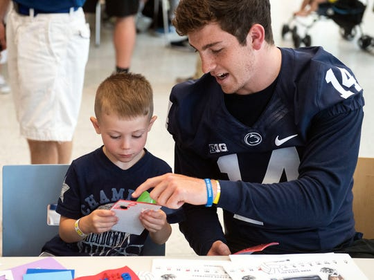 Sean Clifford and other Penn State players shared laughs and hugs during the team's annual visit to Milton S. Hershey Medical Center in 2018.