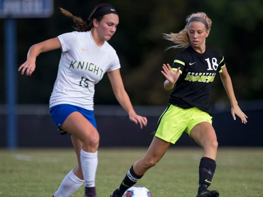 North's Hannah Elmore (18) contains Castle's Avery McKinney (15) at Castle High School in Evansville, Ind., on Tuesday, Oct. 3, 2017. Castle won 2-0.
