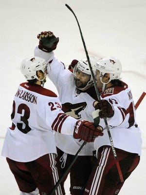 Oliver Eckman-Larsson, Sam Gagner (center) and John Moore celebrate the game-winning goal by Gagner in overtime against the Sabres in Buffalo, N.Y.